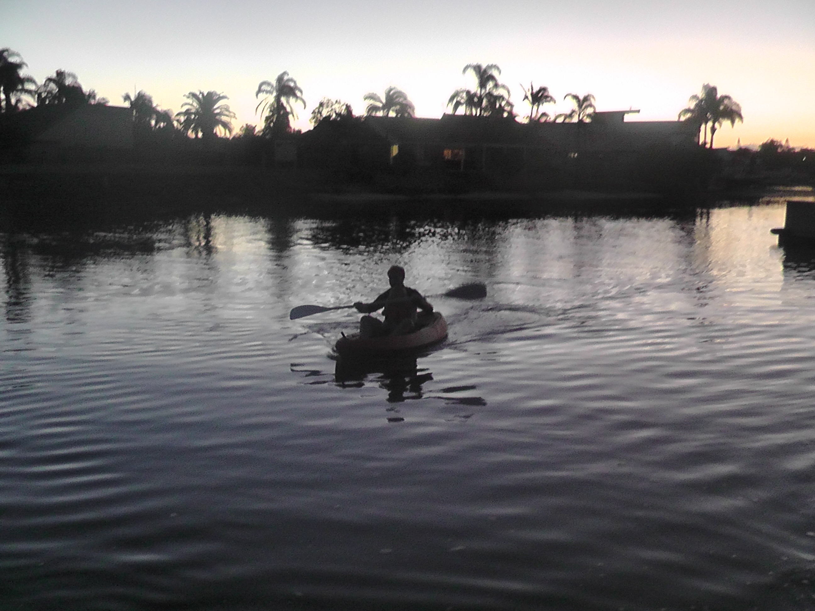 Sunset Kayaking in Mooloolaba - Reuben is in between Lee's legs!