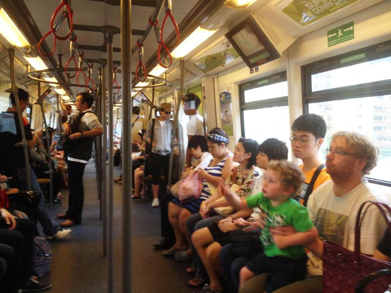 Reuben-riding-Skytrain,-Bangkok-with-kids