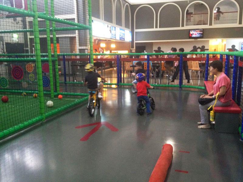 Reuben-riding-bike-at-Funarium,-Bangkok-for-kids
