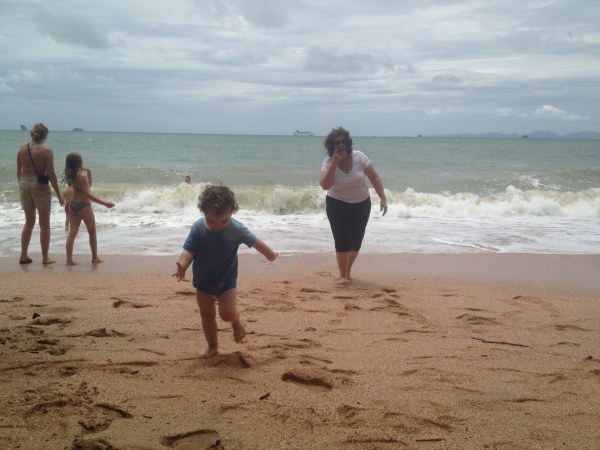 Playing on the Beach in Krabi in the Wet Season, Thailand