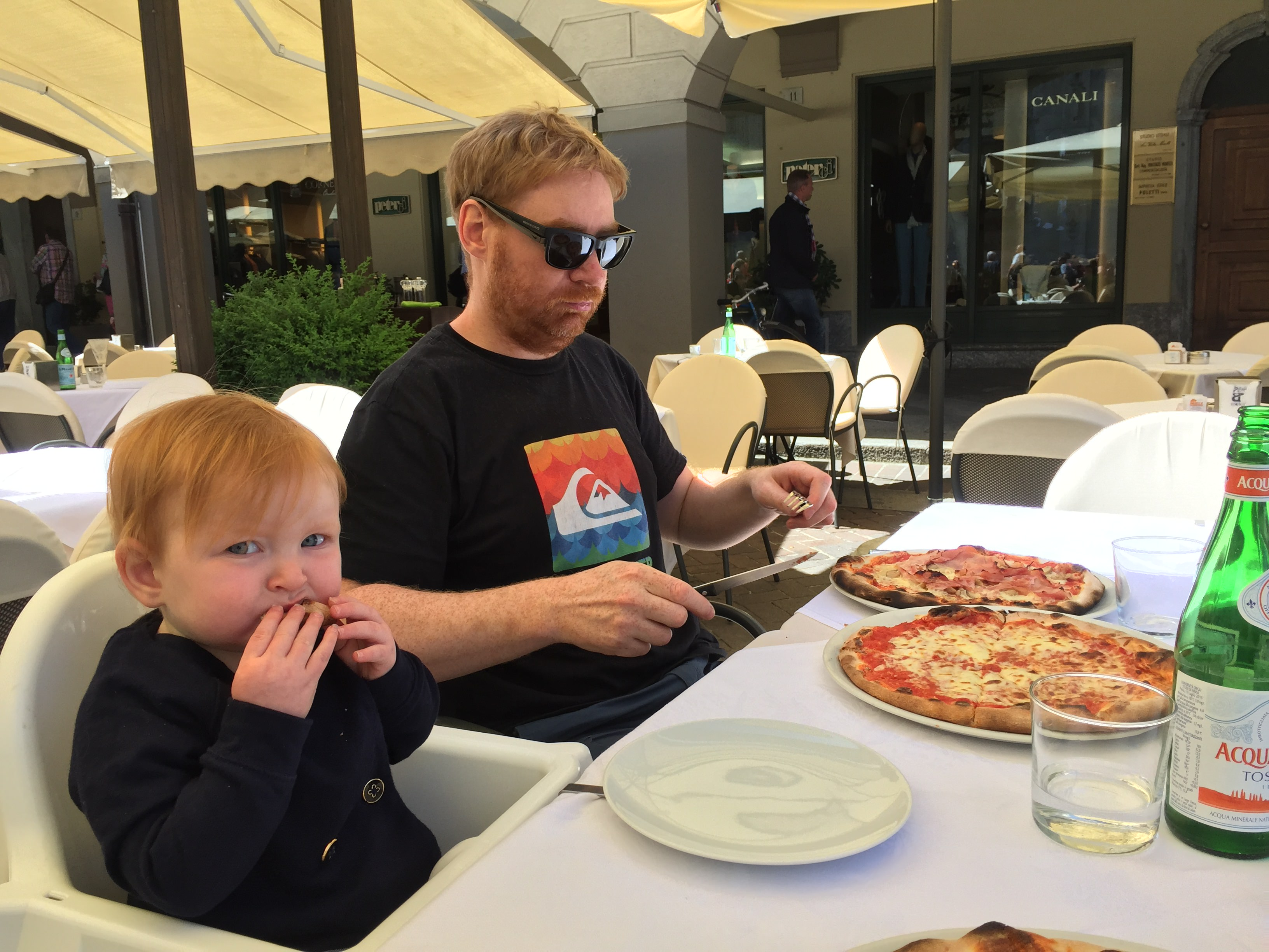 Hazel Eating Pizza in Lake Como, Italy