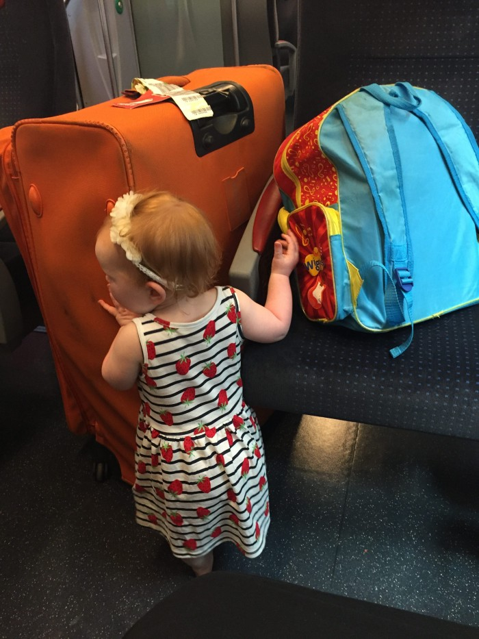 Hazel with our Luggage on Train in Italy
