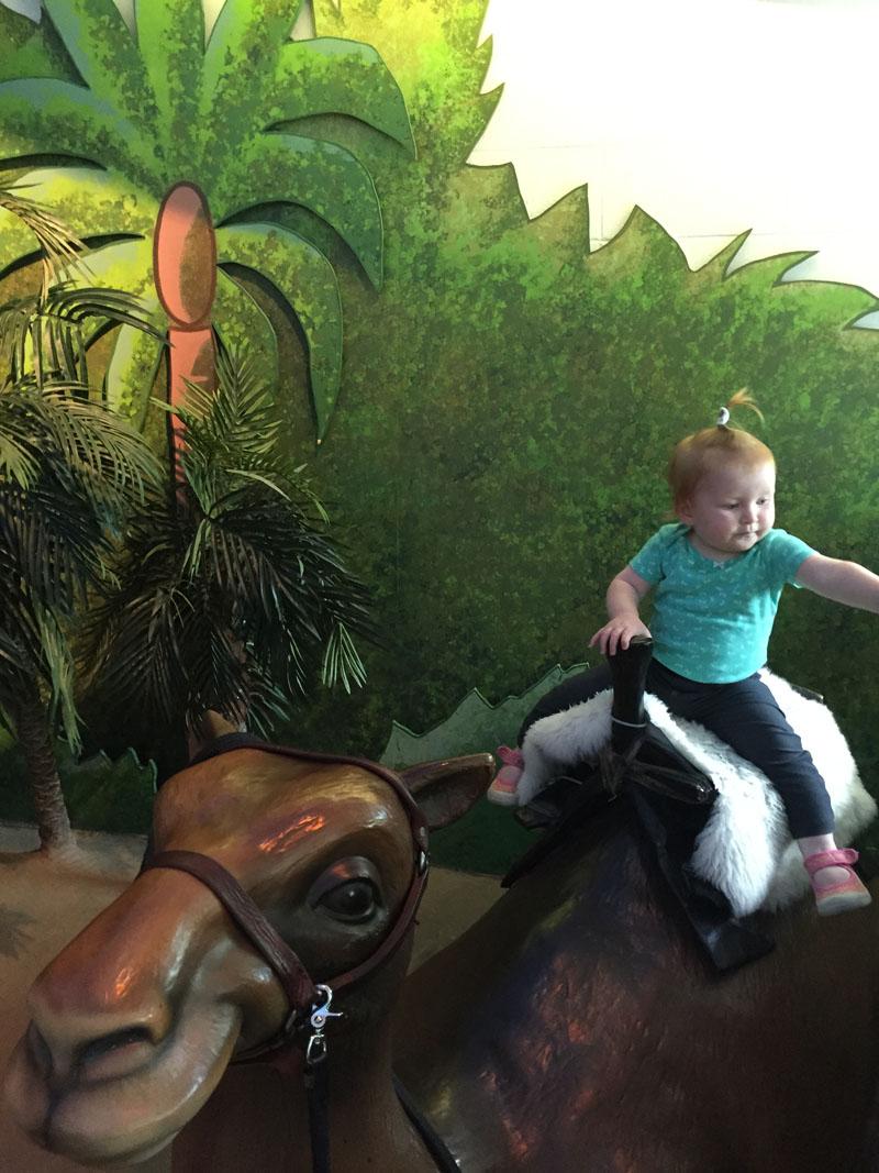 Hazel Riding Camel at Ottawa Childrens Museum