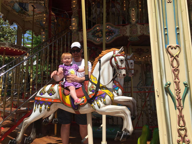 Hazel Riding a Carousel in Nice, France