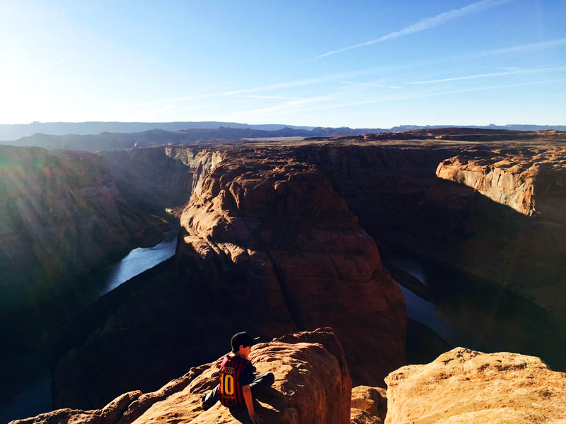 Man Sitting at Horseshoe Bend
