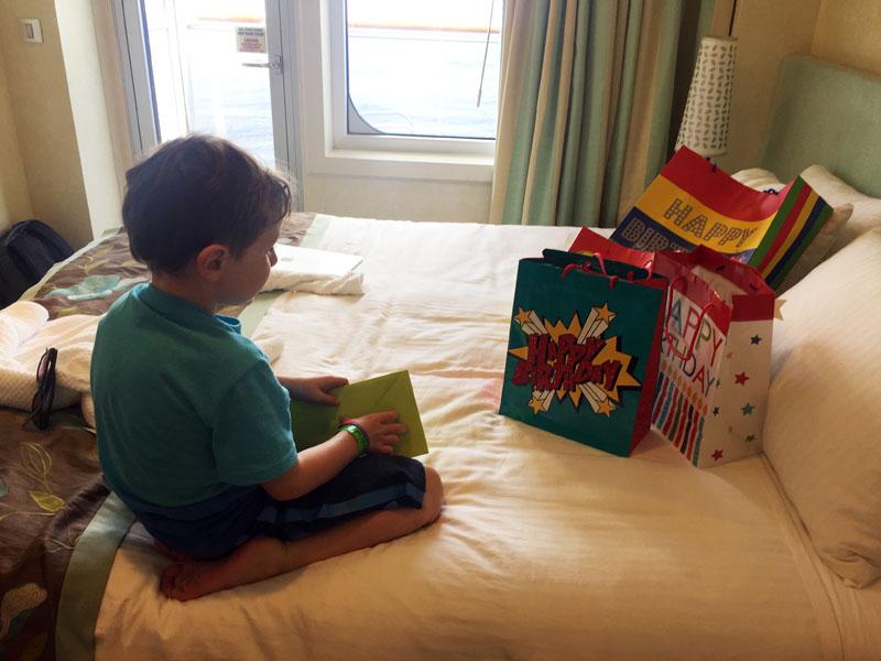 Reuben opening his birthday presents on board