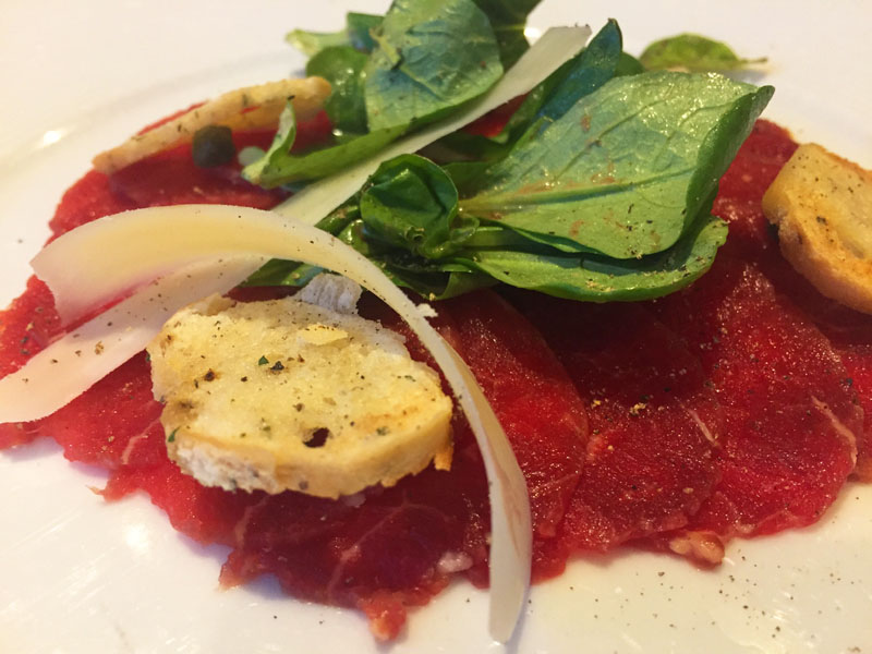 Beef carpaccio at Fahrenheit 555 Steakhouse on Carnival Breeze
