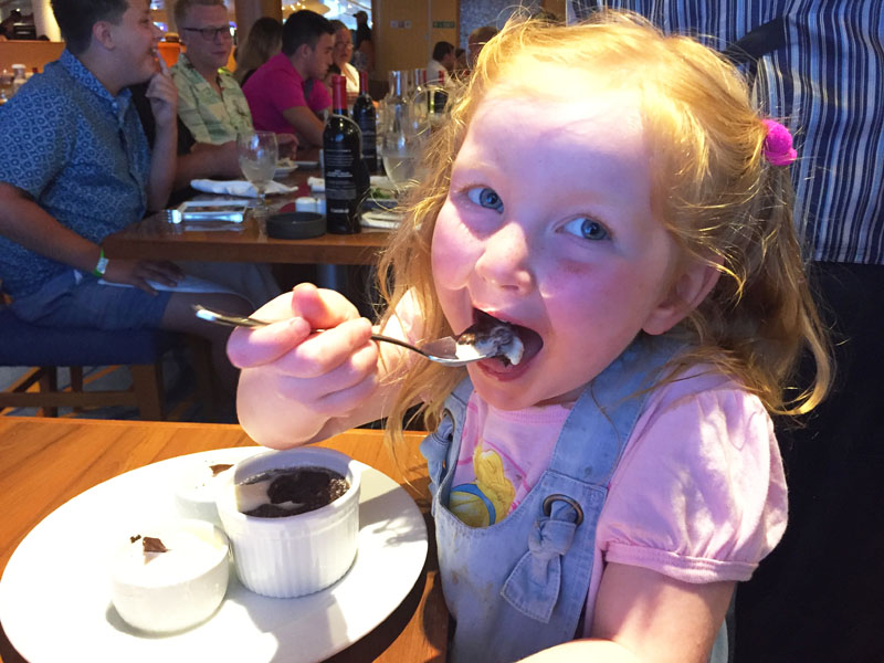 Hazel eating Carnival's famous melting chocolate cake on board the Carnival Breeze
