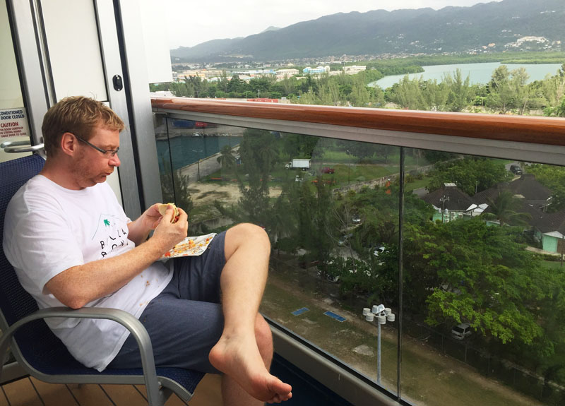 Lee eating tacos on our balcony before heading off to explore Montego Bay, Jamaica