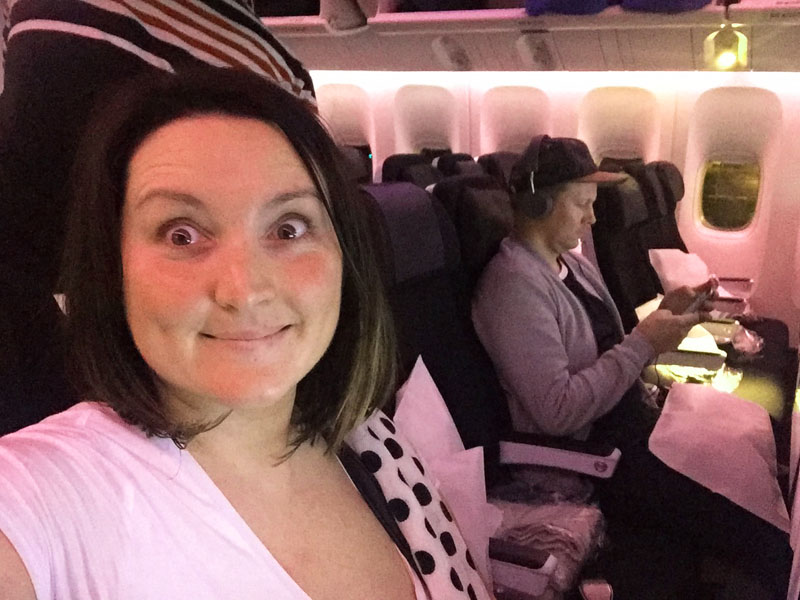 Onboard a flight from Auckland to LAX with one of my long flight essentials - my spotty pashmina!