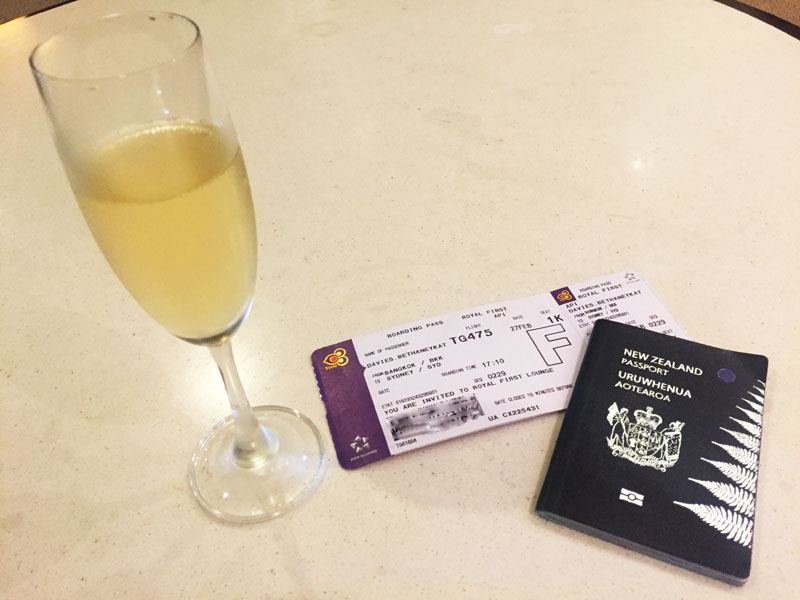 first-class-boarding-pass-passport-and-champagne