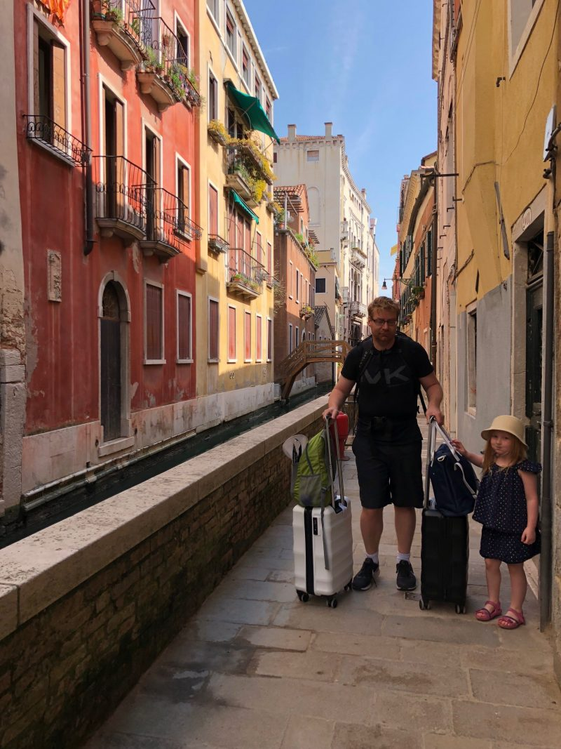 Lee and Hazel with our carry on luggage in Venice